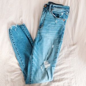High waisted light blue ripped skinny jeans